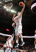CHARLOTTESVILLE, VA- December 3: James Johnson #34 of the Virginia Cavaliers grabs a rebound during the game on December 27, 2011 against the Longwood Lancers at the John Paul Jones Arena in Charlottesville, Virginia. Virginia defeated Longwood 86-53. (Photo by Andrew Shurtleff/Getty Images) *** Local Caption *** James Johnson