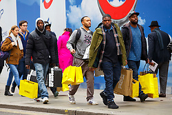© Licensed to London News Pictures. 28/11/2014. LONDON, UK. People shopping on Oxford Street and take advantage of Black Friday discounts on Friday, 28 November 2014. Photo credit : Tolga Akmen/LNP