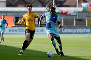 Wycombe Wanderers midfielder Marcus Bean (8) battles for possession with Newport County striker Tom Owen-Evans (20) 0-0 during the EFL Sky Bet League 2 match between Newport County and Wycombe Wanderers at Rodney Parade, Newport, Wales on 9 September 2017. Photo by Alan Franklin.