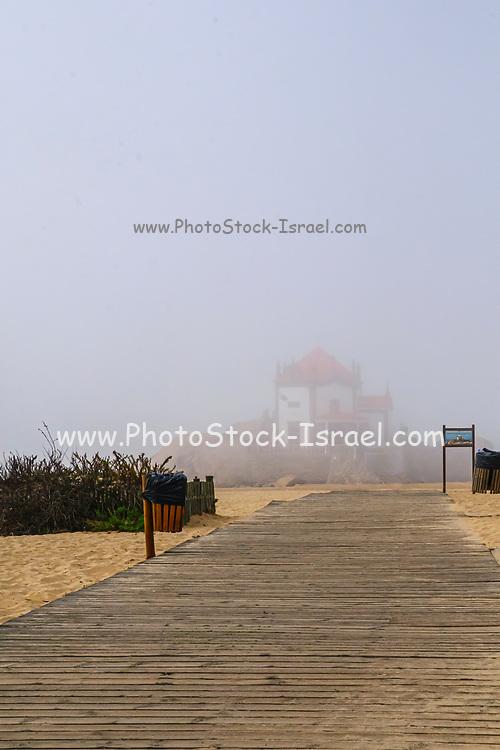 Senhor da Pedra Beach, Vila Nova de Gaia, Portugal was voted the 10th most beautiful beach in Europe. The church can be seen in the fog