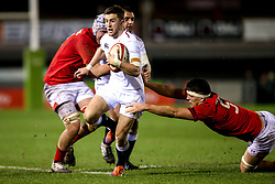 Tom de Glanville of England U20 goes past Teddy Williams of Wales U20 - Mandatory by-line: Robbie Stephenson/JMP - 22/02/2019 - RUGBY - Zip World Stadium - Colwyn Bay, Wales - Wales U20 v England U20 - Under-20 Six Nations
