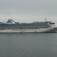 The Star Princess, a massive cruise ship, anchors in the Strait of Magellan, near Punta Arenas, Chile.