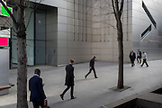 Pedestrians walk through a corporate office space of modern architecture, on 16th February 2017, in the City of London, England.