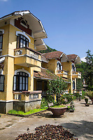 Ochre colored French Colonial Architecture in Sapa - the French colonial government built Vietnamese towns and cities such as Sapa according to European styles and specifications. Many of these structures still stand, converted into cafes, hotels and restaurants.