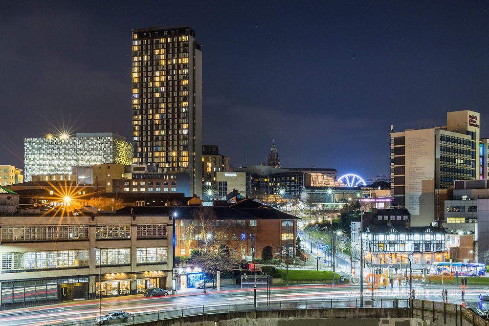 Twilight skies over the Sheffield skyline at night. Sheaf Street and well known buildings are illuminated in this nighttime shot from an elevated viewpoint. An urban cityscape in South Yorkshire, England, UK.