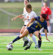 OFallon defender Bronwyn Baer (right) fights for the ball with Edwardsville midfielder Campbell Slemmer. OFallon defeated Edwardsville in a girls soccer playoff game at OFallon High School in OFallon, IL on Tuesday June 8, 2021. <br /> Tim Vizer/Special to STLhighschoolsports.com.