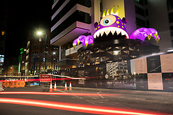 © Licensed to London News Pictures. 25/10/2020. Manchester, UK. Monster at 111 Piccadilly. Giant inflatable monsters have appeared in Manchester ready for event, Halloween in the City, which will see the monsters displayed across the city between the 26th October and 1st November. Photo credit: Kerry Elsworth/LNP