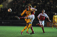 Newport's Rene Howe is tackled by Fleetwood's  Mark Roberts. Skybet football league 2 match, Newport county v Fleetwood Town at Rodney Parade in Newport, South Wales on Tuesday 4th March 2014.<br /> pic by Andrew Orchard, Andrew Orchard sports photography.