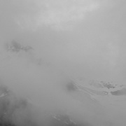 Storm clouds lingering over the peaks of Glacier National Park near the Sperry Chalet.