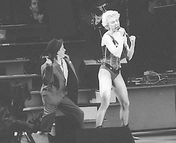 File photo dated 16/08/1987 of Madonna performing on stage at her British debut concert, at the Roundhay Park in Leeds. The pop superstar will celebrate her 60th birthday on Thursday, following a long career of reinvention and controversy.