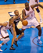 June 2, 2012; Oklahoma City, OK, USA; Oklahoma City Thunder center Kendrick Perkins (5) looks on as guard Russell Westbrook (0) knocks the ball away from San Antonio Spurs guard Tony Parker (9) during the second half of a playoff game at Chesapeake Energy Arena.  Mandatory Credit: Beth Hall-US PRESSWIRE