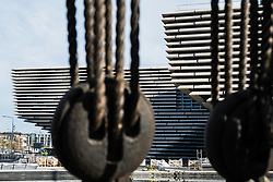 View of the new V&A Museum through rigging of adjacent RSS Discovery ship at Discovery Point in Dundee, Tayside, Scotland, United Kingdom.