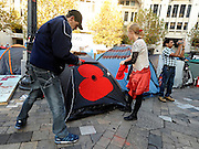© Licensed to London News Pictures. 13/11/2011. London, UK. Protesters decorate their tents with red poppies. Occupy London protest camp During the Remembrance Service held at St Paul's Cathedral in London today, 13th November 2011. Photo credit : Stephen Simpson/LNP