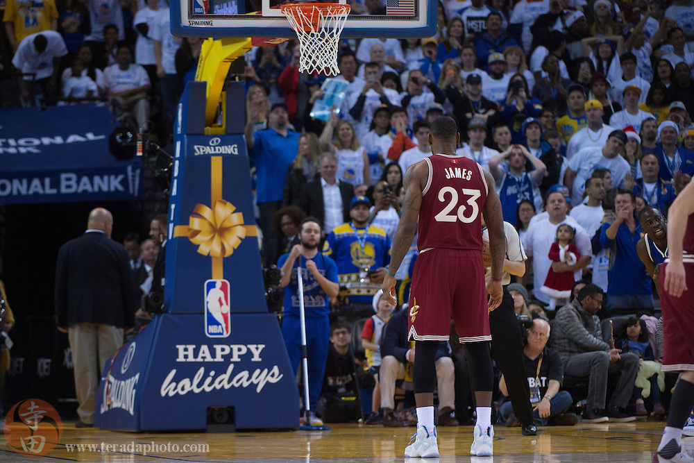 December 25, 2015; Oakland, CA, USA; Cleveland Cavaliers forward LeBron James (23) prepares to shoot a free throw during the fourth quarter in a NBA basketball game on Christmas against the Golden State Warriors at Oracle Arena. The Warriors defeated the Cavaliers 89-83.