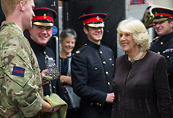 © London News Pictures. 15/10/2015. The Duchess of Cornwall met horses from the Household Cavalry Mounted Regiment in Hyde Park Barracks this evening prior to attending a reception for World Class horse owners.  HRH is  Patron of The British Equestrian Federation. Photo Credit: Sergeant Rupert Frere/LNP