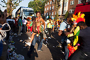 A young female dancer smiles in the arms of spectator. The Notting Hill Carnival has been running since 1966 and is every year attended by up to a million people. The carnival is a mix of amazing dance parades and street parties with a distinct Caribbean feel.