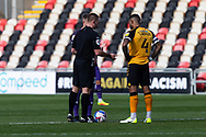 Today's referee Thomas Bramall with the two captains during the EFL Sky Bet League 2 match between Newport County and Tranmere Rovers at Rodney Parade, Newport, Wales on 17 October 2020.