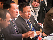 "29 MAY 2015 - BANGKOK, THAILAND:   HTIN LYNN (far right), Special Representative of the Myanmar Ministry of Foreign Affairs, talks to other members of his delegation during the ""Special Meeting on Irregular Migration in the Indian Ocean."" Thailand organized and hosted the meeting at the Anantara Siam Hotel in Bangkok. The meeting brought together representatives from the 5 countries impacted by the boat people exodus: Thailand, Malaysia and Indonesia, which have all received boat people, and Myanmar (Burma) and Bangladesh, where they are coming from. Non-governmental organizations, like the International Organization for Migration (IOM) and UN High Commissioner for Refugees (UNHCR) as well as countries responding to the crisis, like the United States, also attended the meeting. A total of 22 organizations attended the one day conference.    PHOTO BY JACK KURTZ"
