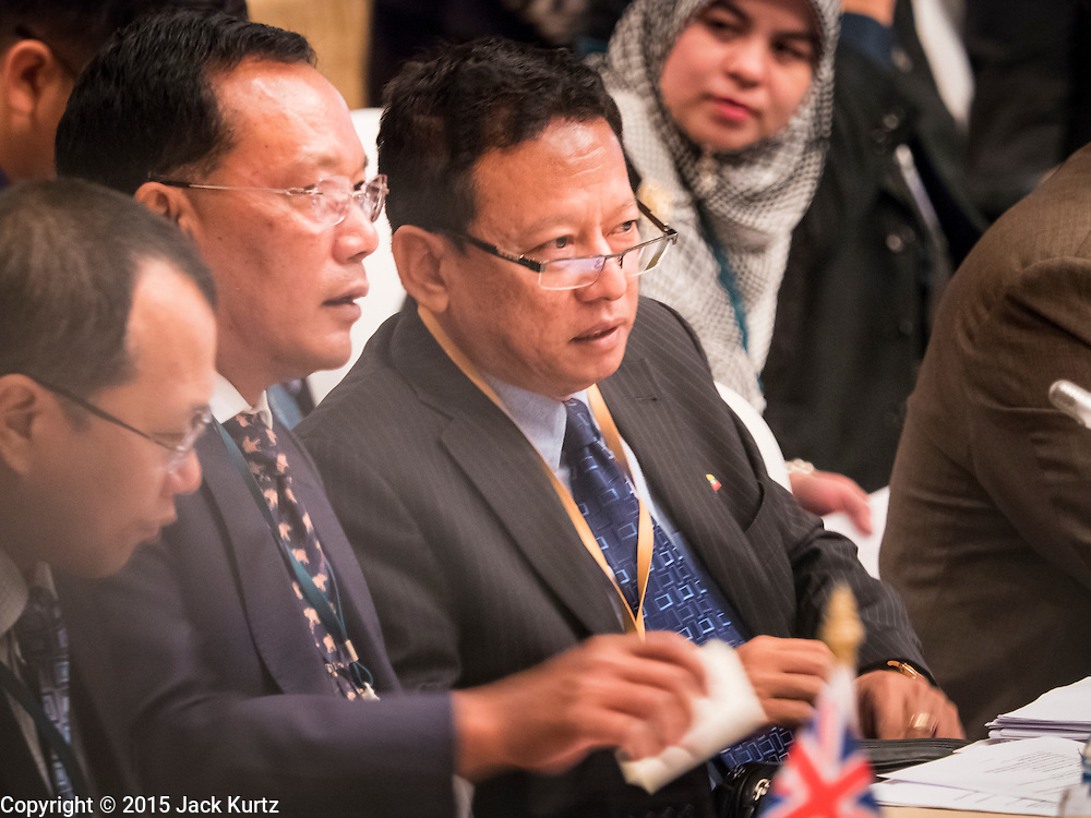 """29 MAY 2015 - BANGKOK, THAILAND:   HTIN LYNN (far right), Special Representative of the Myanmar Ministry of Foreign Affairs, talks to other members of his delegation during the """"Special Meeting on Irregular Migration in the Indian Ocean."""" Thailand organized and hosted the meeting at the Anantara Siam Hotel in Bangkok. The meeting brought together representatives from the 5 countries impacted by the boat people exodus: Thailand, Malaysia and Indonesia, which have all received boat people, and Myanmar (Burma) and Bangladesh, where they are coming from. Non-governmental organizations, like the International Organization for Migration (IOM) and UN High Commissioner for Refugees (UNHCR) as well as countries responding to the crisis, like the United States, also attended the meeting. A total of 22 organizations attended the one day conference.    PHOTO BY JACK KURTZ"""
