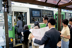 Getting On Bus In Ginza District