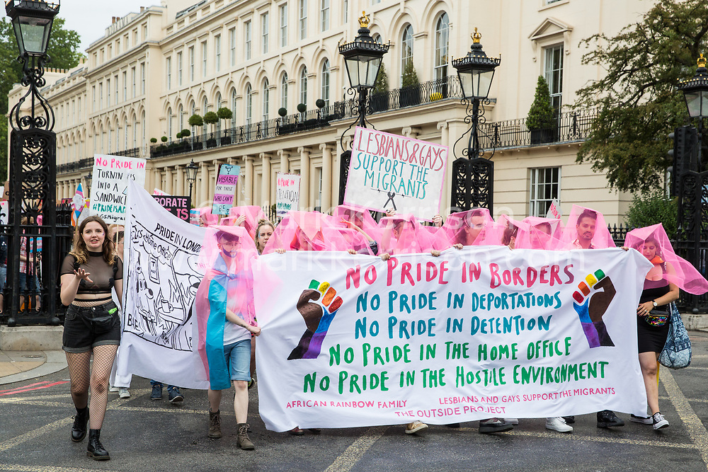 London, UK. 6 July, 2019. Activists from Lesbians and Gays Support The Migrants, African Rainbow Family, the Outside Project, Micro Rainbow and other LGBT+ groups take part in a London Pride Solidarity March in solidarity with those for whom Pride in London is inaccessible and in protest against the corporatisation of Pride in London.