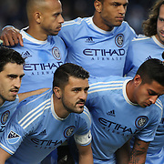 David Villa, (second from left), with his NYCFC team mate during the team group shot before the New York City FC Vs Orlando City, MSL regular season football match at Yankee Stadium, The Bronx, New York,  USA. 18th March 2016. Photo Tim Clayton