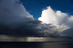 © Licensed to London News Pictures. 28/07/2012..Saltburn, England. A boat is dwarfed by rain clouds forming off the coastline at Saltburn in Cleveland..Photo credit : Ian Forsyth/LNP