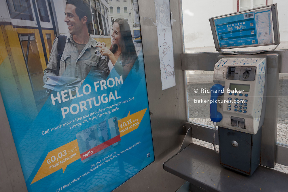 An ad for Portuguese phone rates in a kiosk at Coimbra university, Portugal.