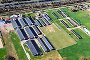 Nederland, Gelderland, Harderwijk, 01-05-2013;<br /> Kippenboerderijen net ten oosten van Harderwijk. Boven in beeld  de spoorbaan (Utrecht - Zwolle) en rijksweg A28.<br /> Poultry farm in the mid-east of the Netherlands, along the railway road and the motorway A28.<br /> luchtfoto (toeslag op standard tarieven)<br /> aerial photo (additional fee required)<br /> copyright foto/photo Siebe Swart