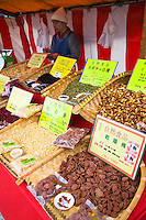 Toji Temple Market Nuts - On the 21st of each month, a famous flea market is held on the grounds of Toji Temple Market. This market is also called Kobo-san, in honor of Kobo Daishi, who died on March 21st. The flea market features a variety of antiques, art, clothes, pottery, some food, and typical second-hand flea market goods. By far the largest special market is held on December 21st, as it is the last of the year.
