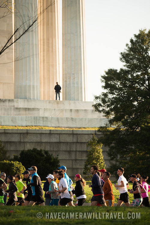 Runners of the Credit Union Cherry Blossom 10 Mile Run pass the Lincoln Memorial. The Cherry Blossom 10-Miler (formally the Credit Union Cherry Blossom 10 Mile Run) is held each spring during the National Cherry Blossom Festival and attracts tends of thousands of runners.