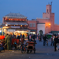 North Africa, Africa, Morocco, Marrakesh. In the evening, the Djeema el Fna fills with food carts and cooks and smells...becoming a giant open-air restaurant.