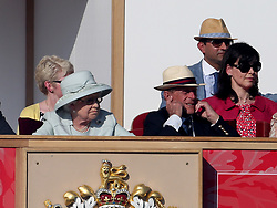 Queen Elizabeth II and the Duke of Edinburgh watch the King's Troop Royal Horse Artillery during the Royal Windsor Horse Show at Windsor Castle, London.