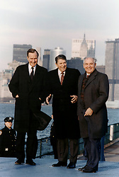 Aug. 13, 1999 - New York, NY, United States of America - U.S. President Ronald Reagan with Soviet General Secretary Mikhail Gorbachev and Vice President George Bush pose with Manhattan as the backdrop during the New York Summit December 7, 1988 in Governor's Island, New York. (Credit Image: © White House/Planet Pix via ZUMA Wire)