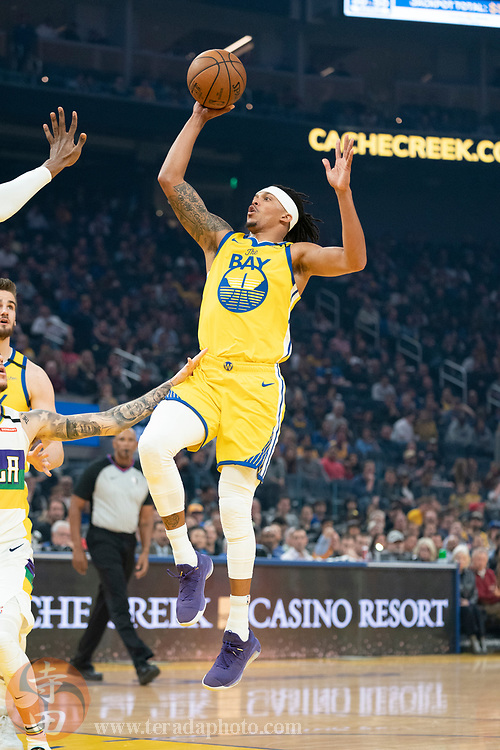 February 23, 2020; San Francisco, California, USA; Golden State Warriors guard Damion Lee (1) shoots the basketball during the first quarter against the New Orleans Pelicans at Chase Center.