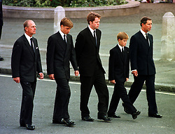 The Prince of Wales, Prince William, Prince Harry, Earl Althorp and Duke of Edinburgh walk behind Diana, the Princess of Wales' funeral cortege.