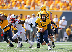 Sep 14, 2019; Morgantown, WV, USA; West Virginia Mountaineers quarterback Austin Kendall (12) runs the ball during the fourth quarter against the North Carolina State Wolfpack at Mountaineer Field at Milan Puskar Stadium. Mandatory Credit: Ben Queen-USA TODAY Sports