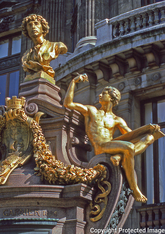 Gilt sculpture outside the Palais Garnier the famous opera house of Paris France on the right bank.