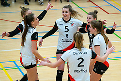 Juliët Huisman of Apollo 8, Florien Reesink of Apollo 8, Rianne Vos of Apollo 8 celebrate during the first league match between Laudame Financials VCN vs. Apollo 8 on February 06, 2021 in Capelle aan de IJssel.