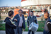 "Father Abdush (2nd left) and his sons Mersid (left), Erdal (3rd left) and Ergul preparing for a drum session on a stage in front of the ""House of Culture"" in Delcevo, Macedonia. The Roma family - father and his 3 sons - are well know for their drum perfomances and also they build their drums themselves."