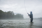 On a rainy summer day, Pat Bogdan spey casts for chinook salmon on a remote BC river.