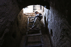 November 4, 2016 - Douma, Damascus, Syria - View of Abu Omar's family shelter in the rebel-held town of Douma, on the eastern outskirts of Damascus, on November 4, 2016. Abu Omar, with the help of his neighbour, was able to dig and prepare an underground shelter consisting of a single room in the space of 2 weeks. The shelter is 4 meters below ground and has an air vent for emergencies. (Credit Image: © Samer Bouidani/NurPhoto via ZUMA Press)