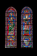 Medieval Window of the South Transept of the Gothic Cathedral of Chartres, France- Circa 1225-30. A UNESCO World Heritage Site. These windows were a donation of the Mauclerc family, the Counts of Dreux-Bretagne, who are depicted with their arms in the bases of the lancets above (right) is the Virgin Mary & Child and (left) is one of the four evangelists sitting on the shoulders of a Prophet - a rare literal illustration of the theological principle that the New Testament builds upon the Old Testament. .<br /> <br /> Visit our MEDIEVAL ART PHOTO COLLECTIONS for more   photos  to download or buy as prints https://funkystock.photoshelter.com/gallery-collection/Medieval-Middle-Ages-Art-Artefacts-Antiquities-Pictures-Images-of/C0000YpKXiAHnG2k
