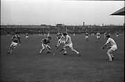 10/09/1967<br /> 09/10/1967<br /> 10 September 1967<br /> Under-21 Hurling Final: Dublin v Tipperary at Croke Park, Dublin.<br /> A Tipperary forward gains possesion of the ball from a Dublin back and scores a point.