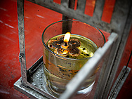Ceremonial offering at Sintoist Thian Hock Temple. Chinatown. Singapore.