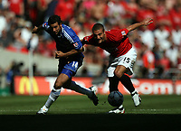 Photo: Rich Eaton.<br /> <br /> Manchester United v Chelsea. FA Community Shield. 05/08/2007. Chelsea's Claudio Pizarro (l) tries to get away from Nemanja Vidic.