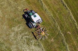 THEMENBILD - ein Landwirt mit seinem Traktor und Heuwender auf einer Wiese, aufgenommen am 04. Juni 2019 in Kaprun, Oesterreich // a farmer with his tractor with Hay tedder in a meadow in Kaprun, Austria on 2019/06/04. EXPA Pictures © 2019, PhotoCredit: EXPA/ JFK