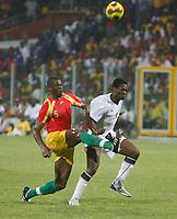 Photo: Steve Bond/Richard Lane Photography.<br />Ghana v Guinea. Africa Cup of Nations. 20/01/2008. Bobo Balde (L) strongly challanges Asamoah Gyan (R)