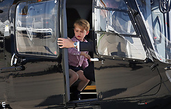 Prince George stands in a rescue helicopter during a visit to Airbus in Hamburg, Germany with the Duchess of Cambridge and sister Princess Charlotte.