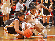 Feb. 3, 2011; Charlottesville, VA, USA; Virginia Cavaliers guard Ariana Moorer (15) fights for the loose ball with Wake Forest Demon Deacons guard Mykala Walker (13) during the game at the John Paul Jones Arena. Virginia won 73-46. Mandatory Credit: Andrew Shurtleff